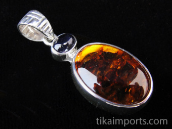 Sterling silver pendant with woven pattern on bail featuring amber and iolite accent stone