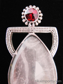 Sterling silver pendant featuring rose quartz with garnet accent stone, bail on back.