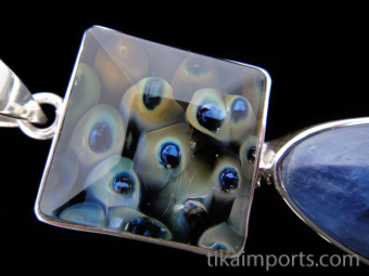 Sterling silver pendant featuring an Kevin O'Grady art glass set above natural kyanite