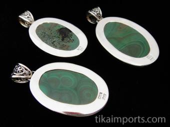 Sterling silver pendant featuring malachite stone with decorative filigree bail