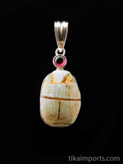 Sterling silver pendant featuring a carved faience scarab with rhodolite accent stone