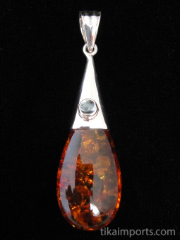 Drop-shaped amber with aquamarine accent on silver cap