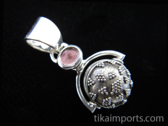 Sterling silver pendant featuring a handmade granulated silver bead suspended below tourmaline accent stone