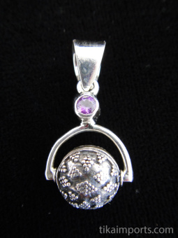 Sterling silver pendant featuring a handmade granulated silver bead suspended below amethyst accent stone