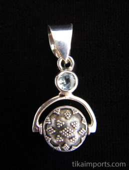 Sterling silver pendant featuring a handmade granulated silver bead suspended below aquamarine accent stone