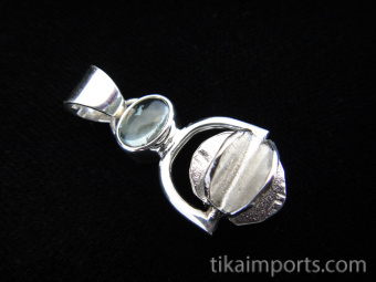 Sterling silver pendant featuring a handmade silver bead suspended below aquamarine accent stone