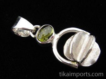 Sterling silver pendant featuring a handmade silver bead suspended below peridot accent stone