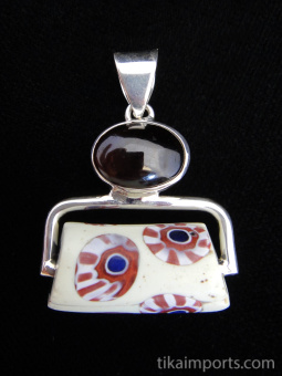 Sterling silver pendant featuring an Antique African Trade Bead suspended below garnet accent stone