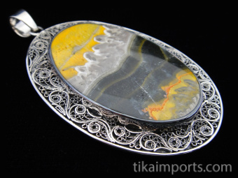 Sterling silver pendant featuring bumble bee jasper framed in a filigree setting