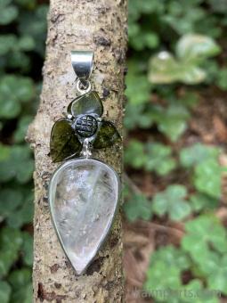 Sterling silver pendant featuring a handcarved tourmaline trillium set above quartz with a pyrite inclusion