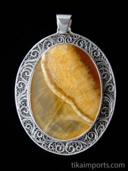 Sterling silver pendant featuring a gorgeous slice of fossilized ammonite framed in elaborate filigree setting