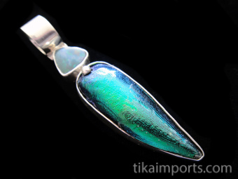 Sterling silver pendant featuring natural wing casing from the Sternocera aequisignata beetle and Australian doublet opal, set with hinged bail.
