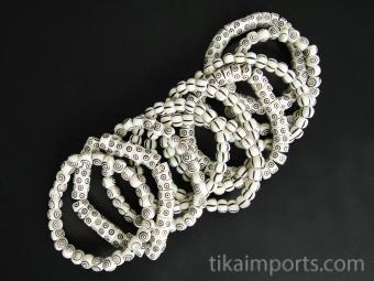 10pc assortment of striking carved bone stretch bracelets