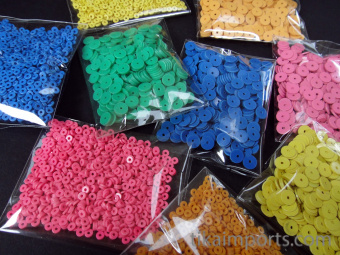 packs of Vintage African Vinyl Disc Beads available in Tiny or Small size