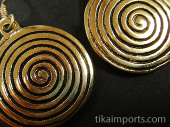 closeup of Sacred Spiral Brass Earrings in gold-tone brass with vermeil earwires