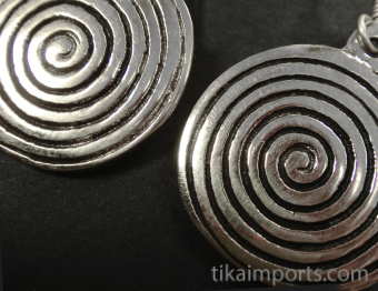 closeup of Sacred Spiral Brass Earrings in silver-tone brass with sterling silver earwires