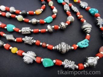Himalayan treasures multistrand necklace, featuring a colorful collection of stone, glass and white brass beads