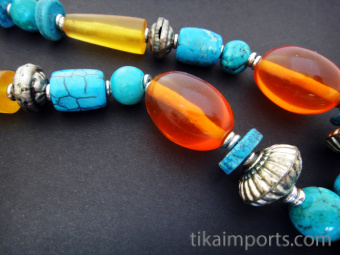 Tibetan style beaded necklace featuring handmade pendant using traditional techniques