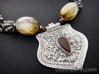 Turkoman Princess Necklace with bone and resin beads, featuring brass pendant inspired by traditional Turkoman silverwork