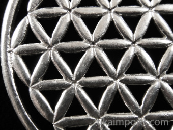closeup of silver-toned brass pendant with Flower of Life design from Sacred Geometry Tradition
