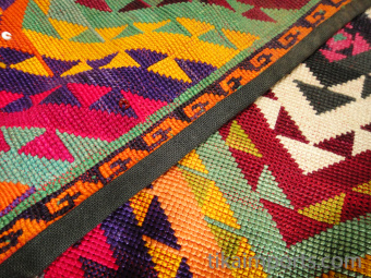 closeup of Vintage two-piece embroidered tassel set from Central Asia