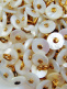 100 pieces of Victorian shell boot-buttons, made in pre-1920's in Muscatine, Iowa