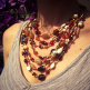 Example of a multi-strand Malala Necklace in red tones
