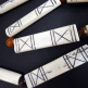 Long carved bone beads strung on cotton cord with either horn or ebony spacer beads