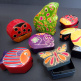 whimsical coin banks and boxes handmade in India from natural, painted leather