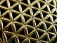 closeup of brass pendant with Flower of Life design from Sacred Geometry Tradition
