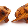 side view of handcarved boxwood frog button