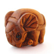 side view of handcarved boxwood elephant button