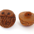 handcarved boxwood owl button showing two pieces