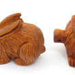 handcarved boxwood rabbit buttons, showing two pieces