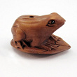 handcarved boxwood ojime bead with frog sitting on a leaf.