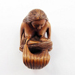 front view of nursing mermaid handcarved boxwood ojime bead