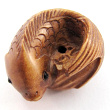 handcarved boxwood ojime bead of fish showing hole through center of tail
