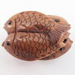 handcarved boxwood ojime bead of four fish