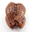 handcarved boxwood ojime bead of four fish showing hole through center of four fish