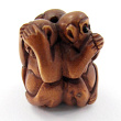 handcarved boxwood ojime bead of three monkeys
