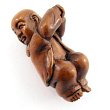 handcarved boxwood ojime bead of buddha baby
