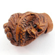 handcarved boxwood ojime bead of dragon