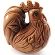 handcarved boxwood ojime bead of rooster