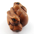 handcarved boxwood ojime bead of rabbits