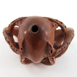 handcarved boxwood ojime bead of octopus showing hole from top to bottom