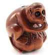 handcarved boxwood ojime bead of monkey on a gourd