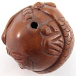 top view of handcarved boxwood ojime bead of mermaid