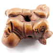handcarved boxwood ojime bead of buddha babies showing hole in between two babies