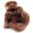 handcarved boxwood ojime bead of fu dog