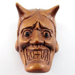 handcarved boxwood ojime bead of Oni mask with hole for stringing
